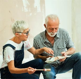 A couple looking at home decorating plans