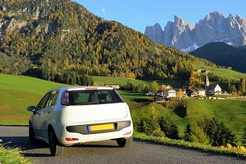 Car looking over Italian village and mountains