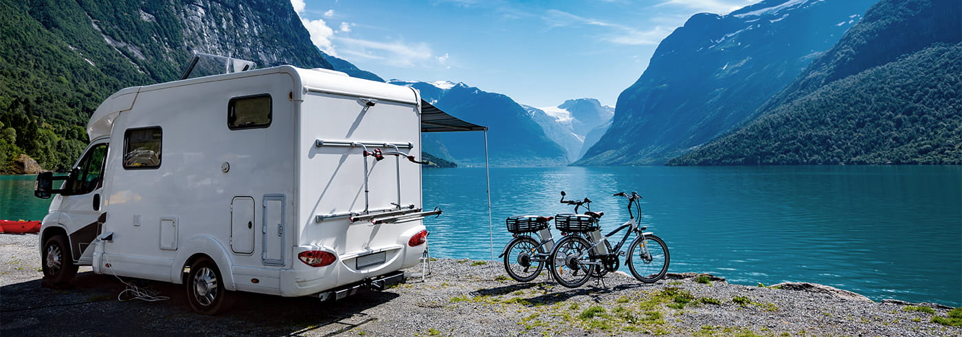Motorhome by a lake with bikes