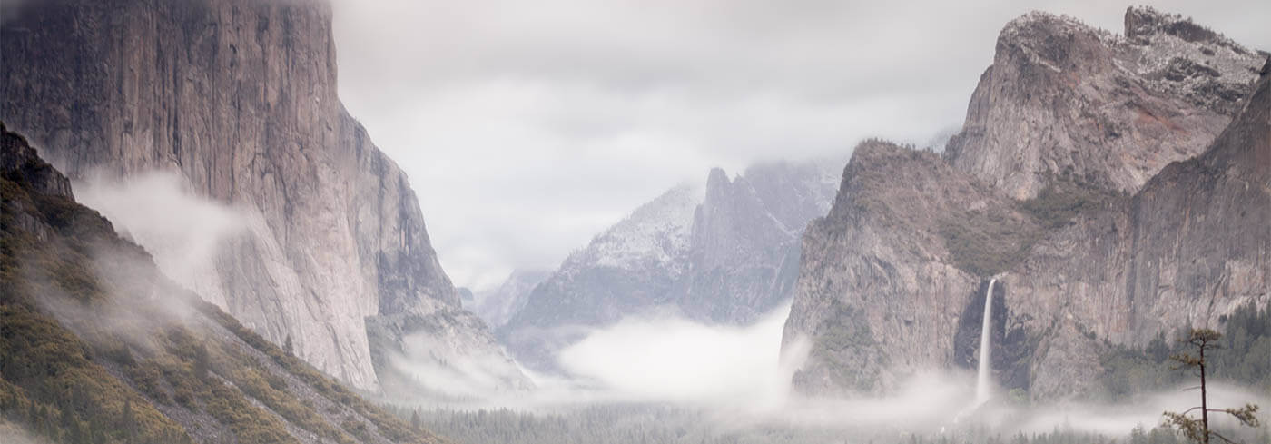 Misty mountains with grey sky