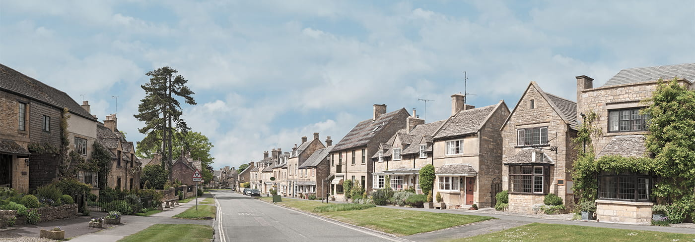 Cotswolds village street panorama with residential houses
