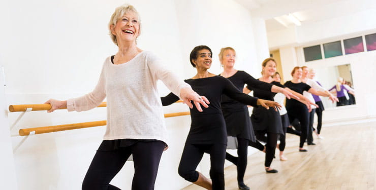 Royal Academy of Dance's Silver Swans practicing and laughing in a dance studio