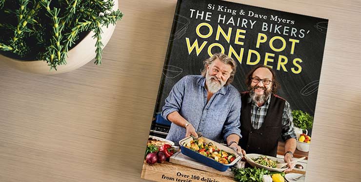 One Pot Wonders cookbook on table next to plant