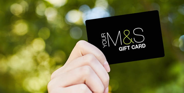 Hand holding a Marks and Spencer gift card