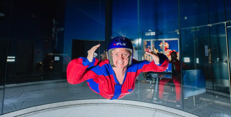 A person indoor skydiving