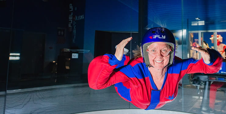iFLY indoor skydiving - woman in skydiving wind tunnel. Photo: Ryan Flood