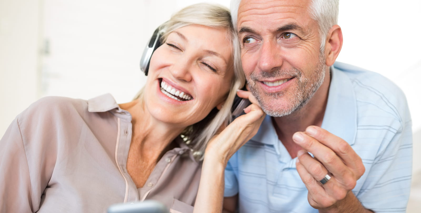 Couple with headphones on