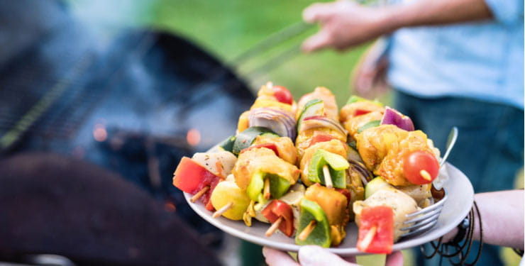Closeup of a plate of skewers at a barbecue