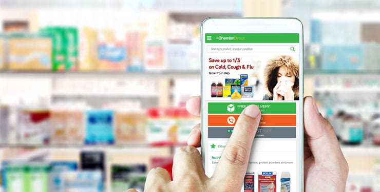 Chemist Direct hand with mobile phone
