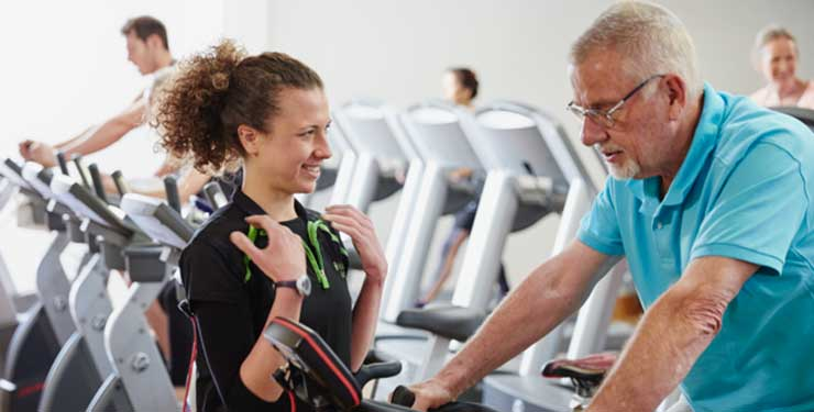 Nuffield Health fitness instructor advising cyclist