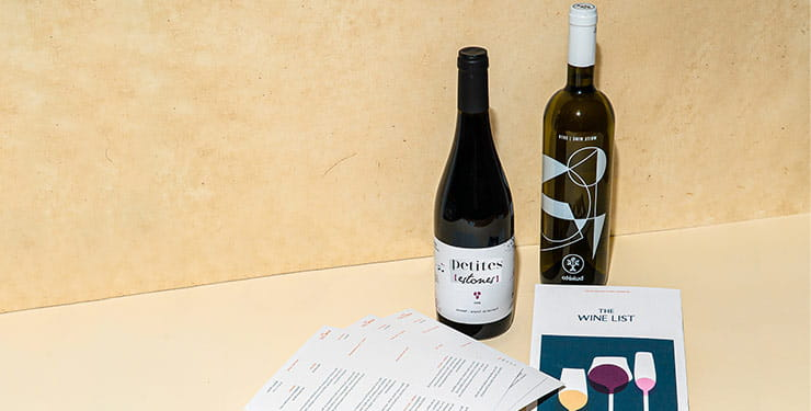 Wine box content example from Wine List, including 2 bottles of wine, tasting cards and leaflet.