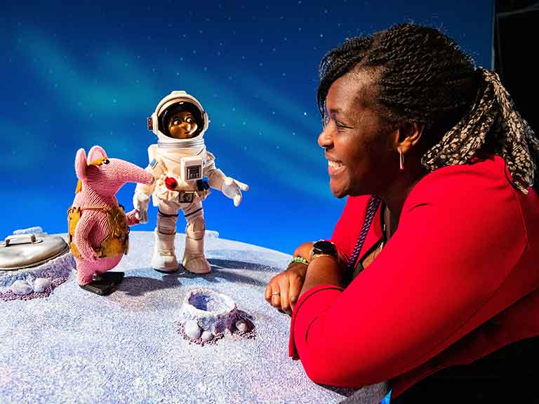 Dr Maggie Aderin Pocock meets her puppet in The Clangers for the first time  © Jody Hartley