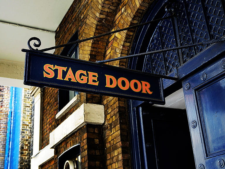A sign saying Stage Door in London's West End