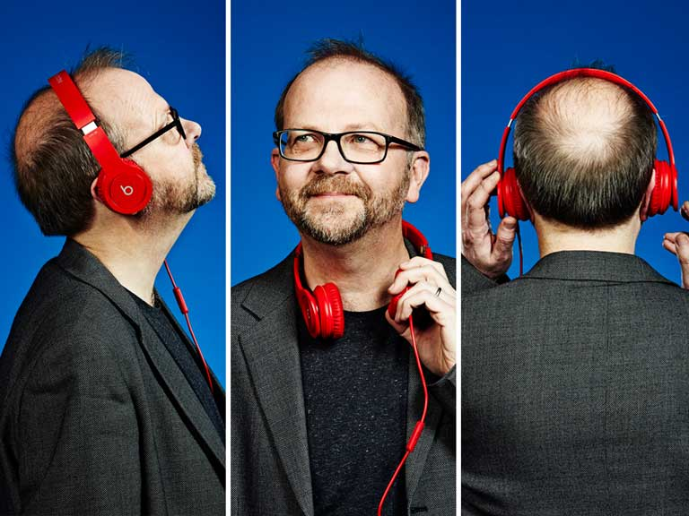 BBC Radio 2's Head of Music, Jeff Smith, wears red headphones