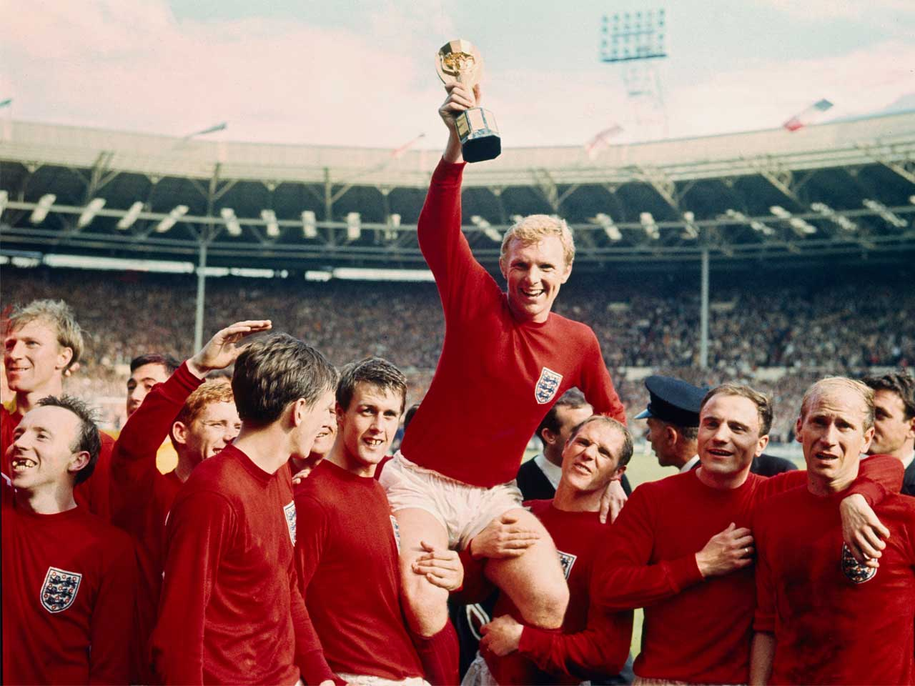 Bobby Moore celebrates with his England football team-mates after winning the football world cup in 1966