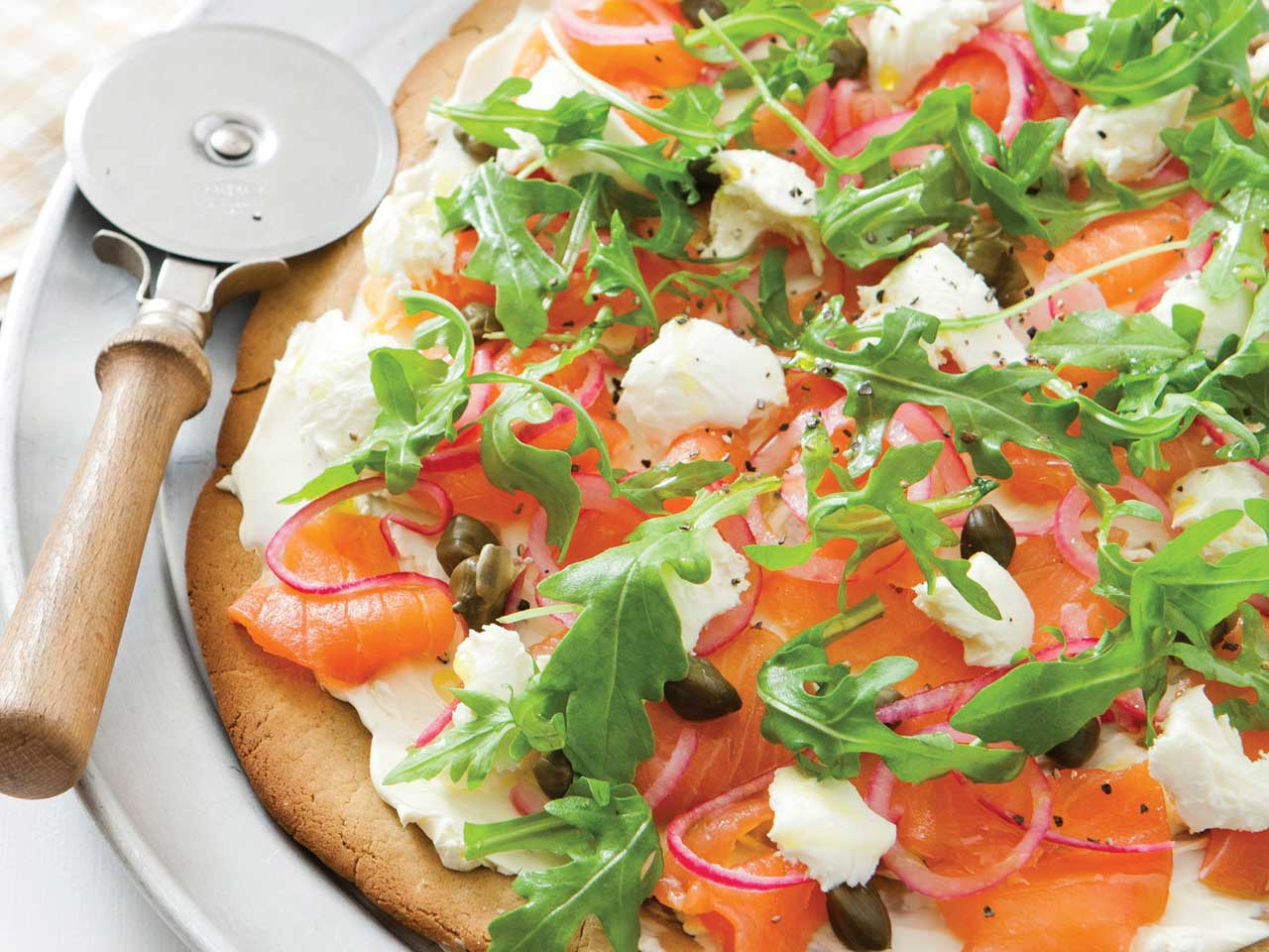 Gluten free quinoa pizza with smoked salmon