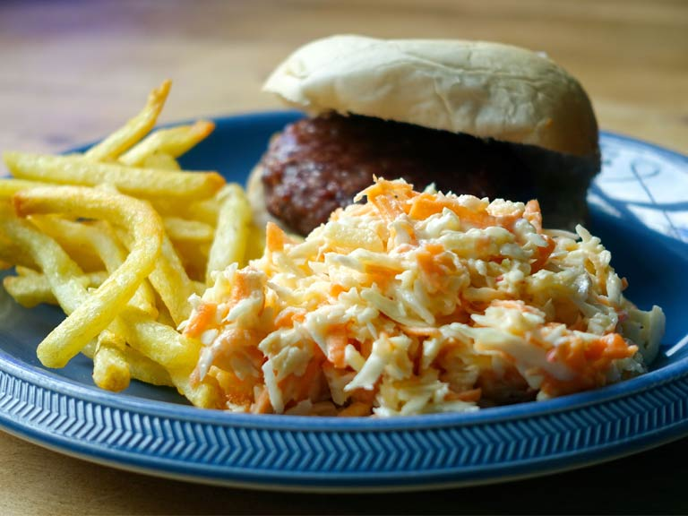 Classic coleslaw with burger and chips