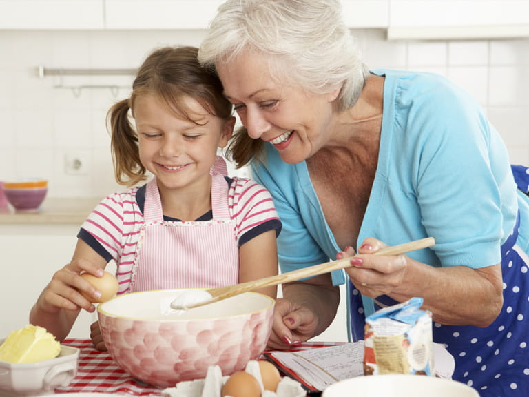 Grandmother baking with child