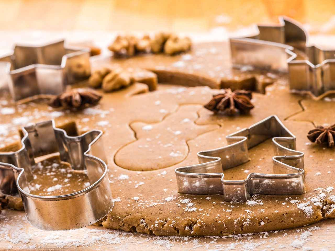 Cinnamon biscuit dough with christmas cookie cutters