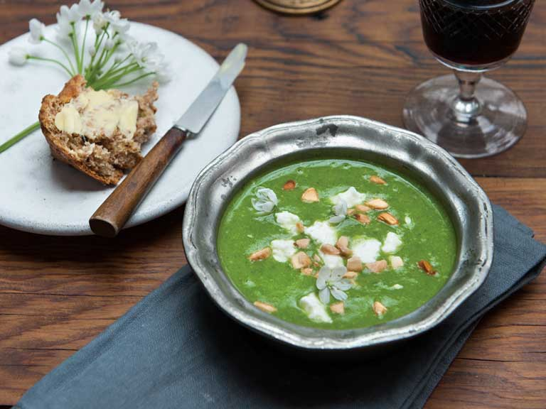 Wild garlic soup with toasted almonds and sheep's cheese
