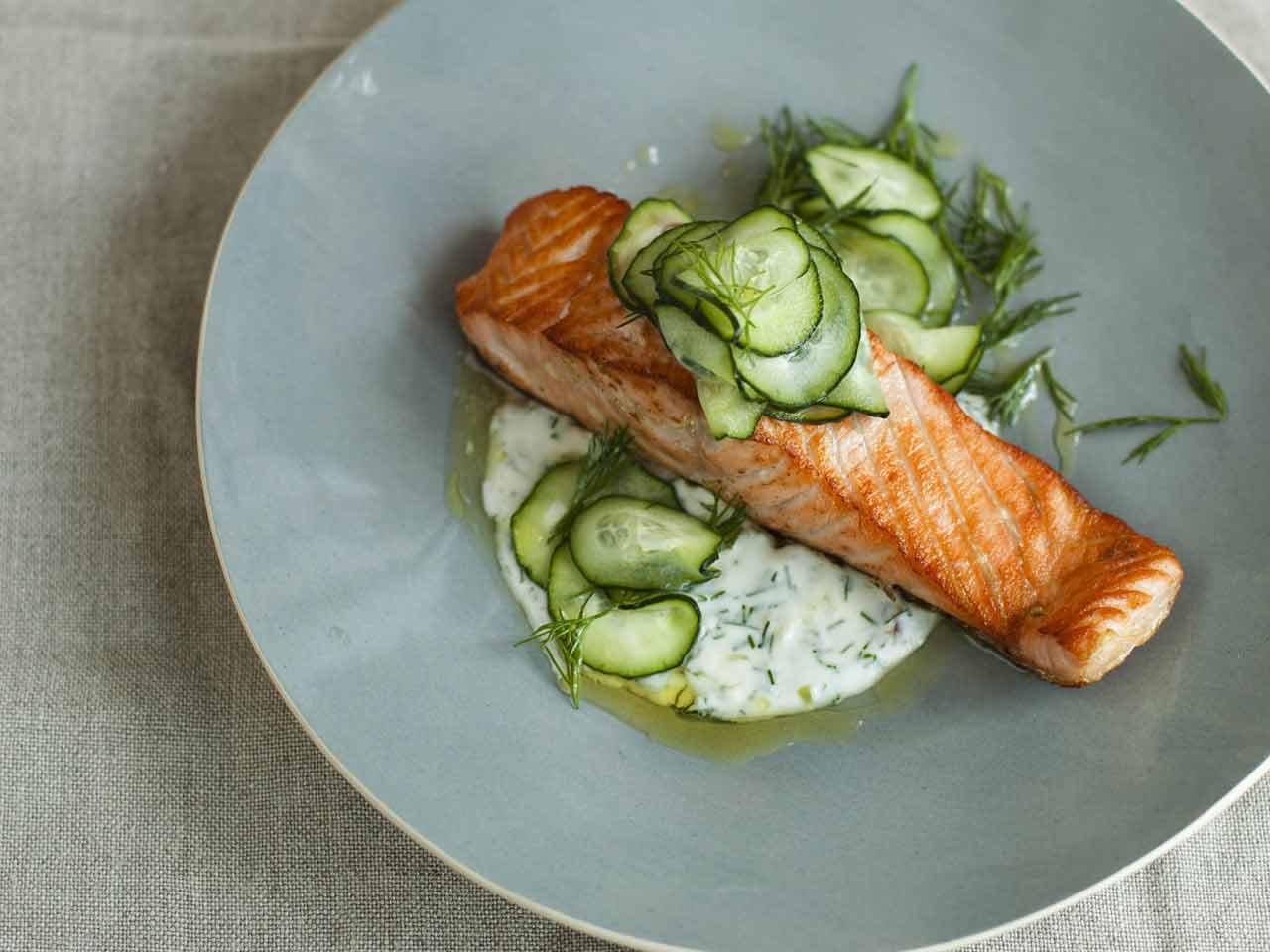 Salmon fillets with cream and dill sauce and quick pickled cucumber