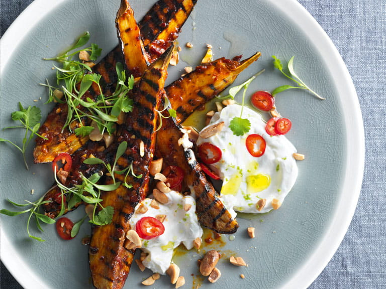 Harissa-glazed aubergine with coconut and peanuts