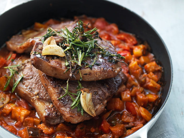 Herb-marinated lamb steaks with Mediterranean stew