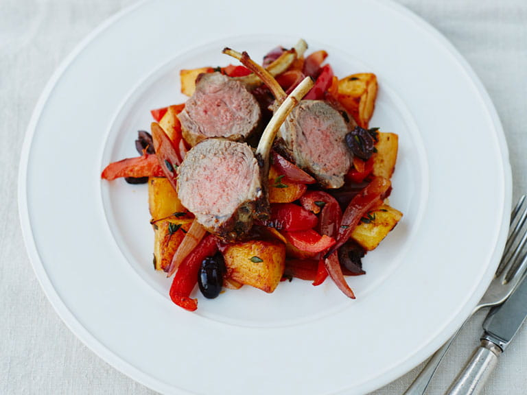 Lamb cutlets with roast King Edward potatoes, smoked paprika, peppers, onions and olives