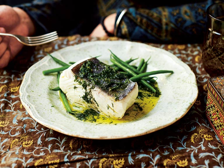 Poached halibut in a buttery dill sauce