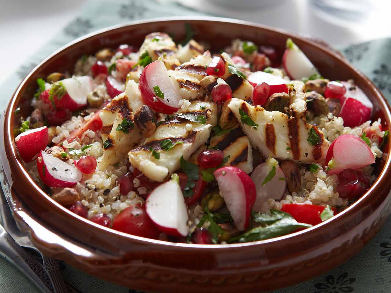 Radish and quinoa tabouleh with pistachios and grilled, herbed halloumi