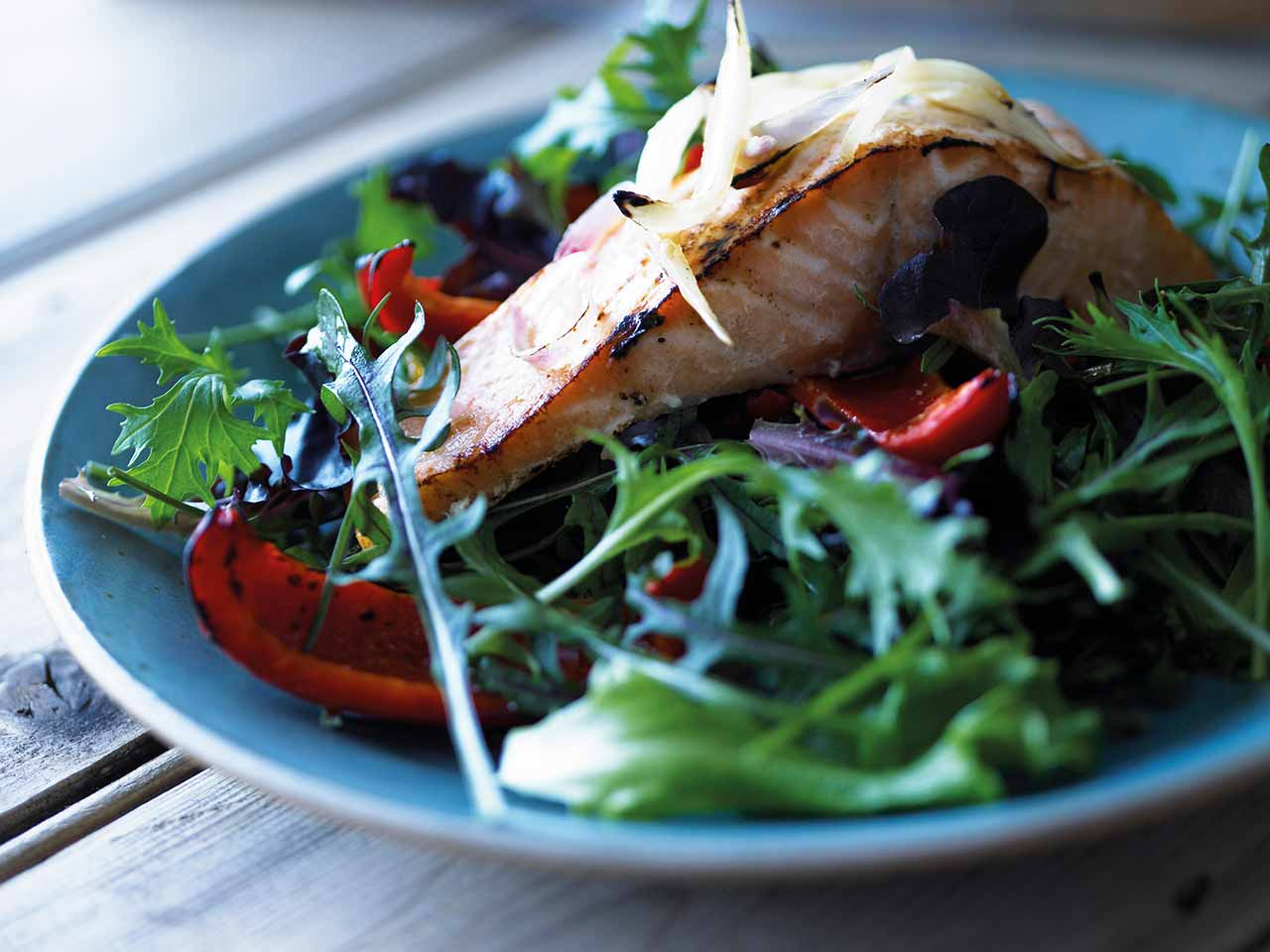 Warm wild red rocket salad with salmon