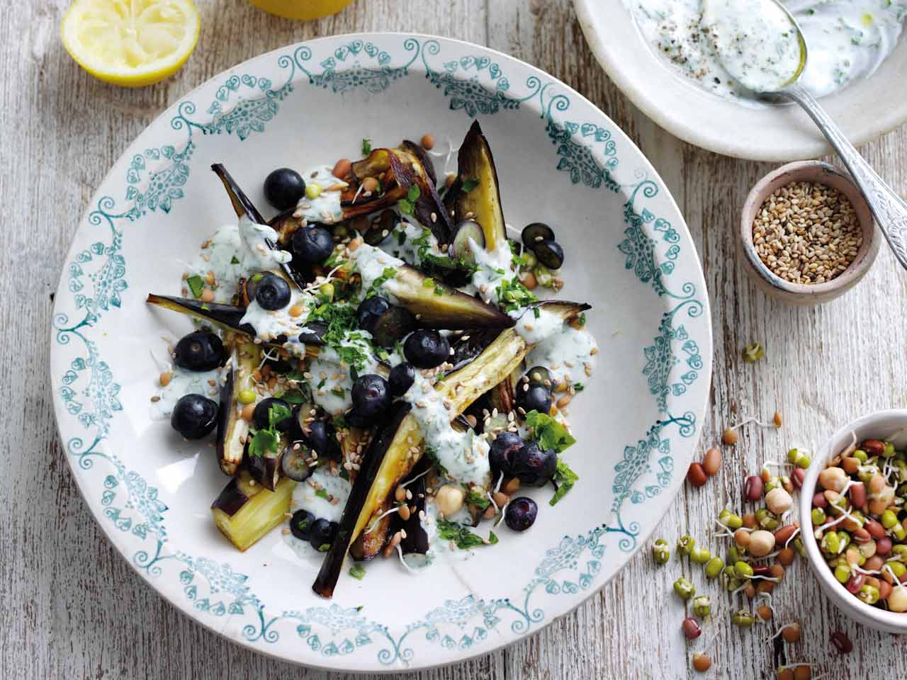 Roast aubergine with yoghurt, sliced blueberries and parsley