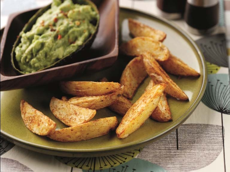 Spicy potato wedges and an avocado dip