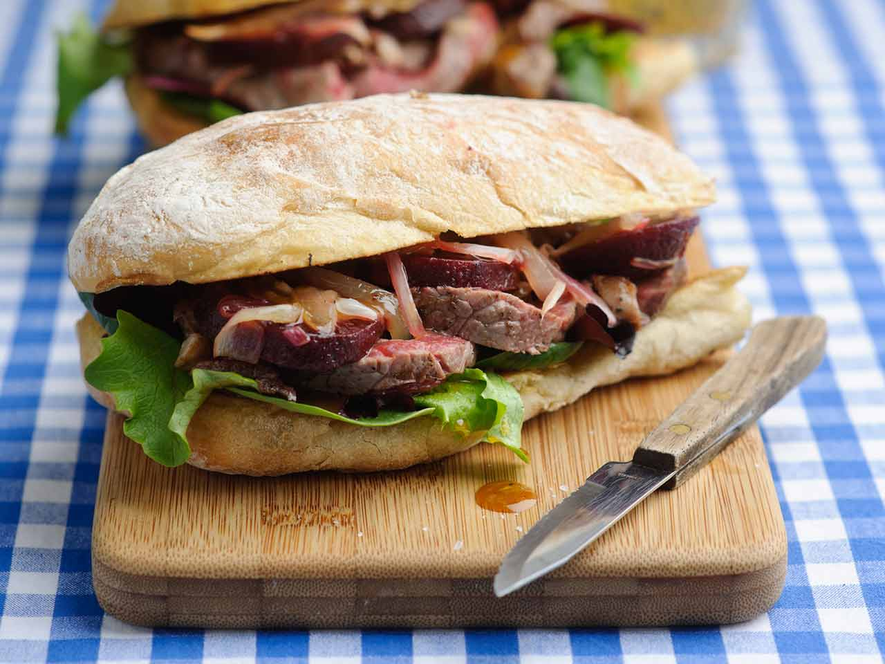 Warm steak and beetroot sandwich with honey and mustard dressing