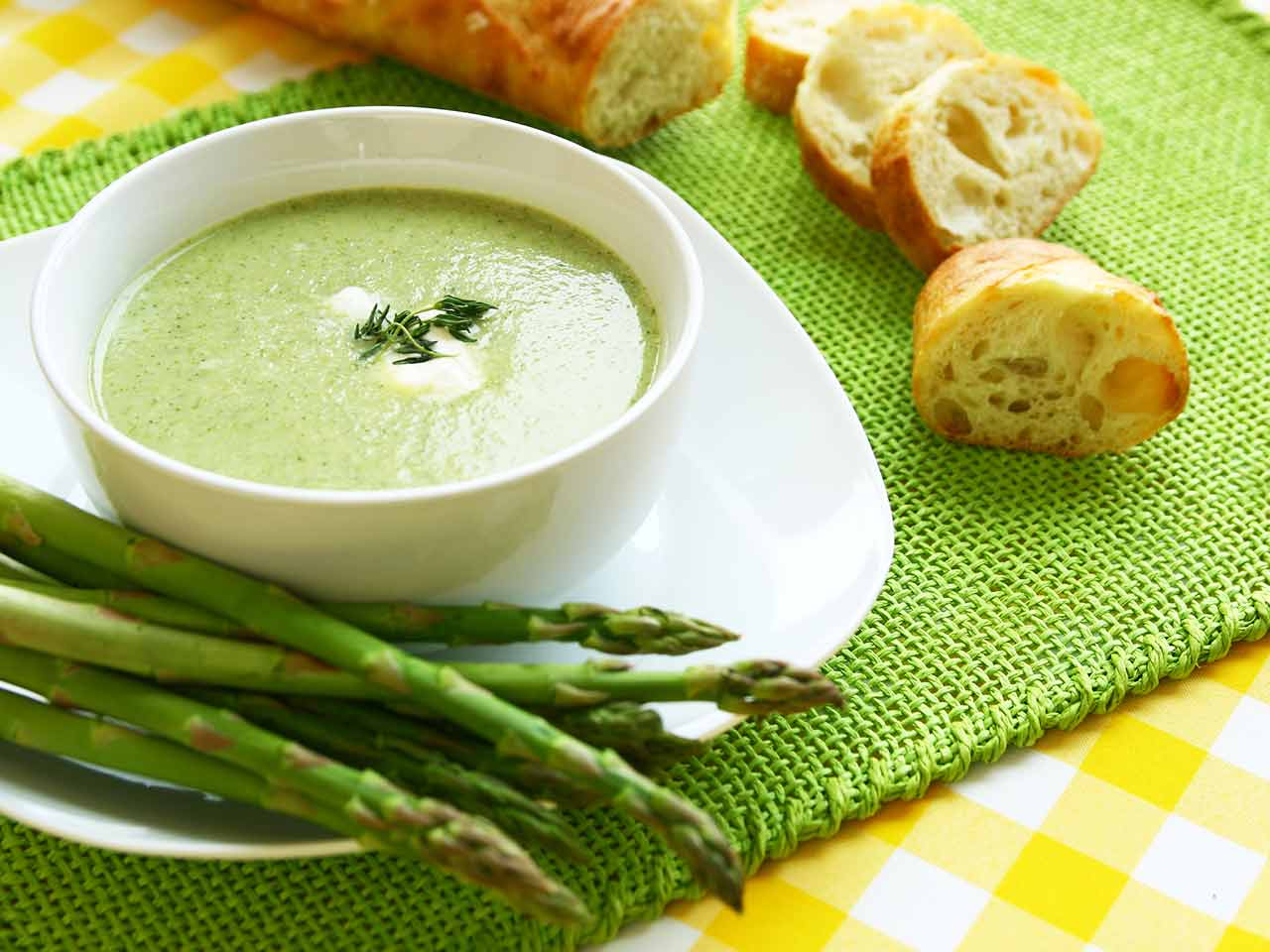 Asparagus and spinach soup topped with chive crème fraîche