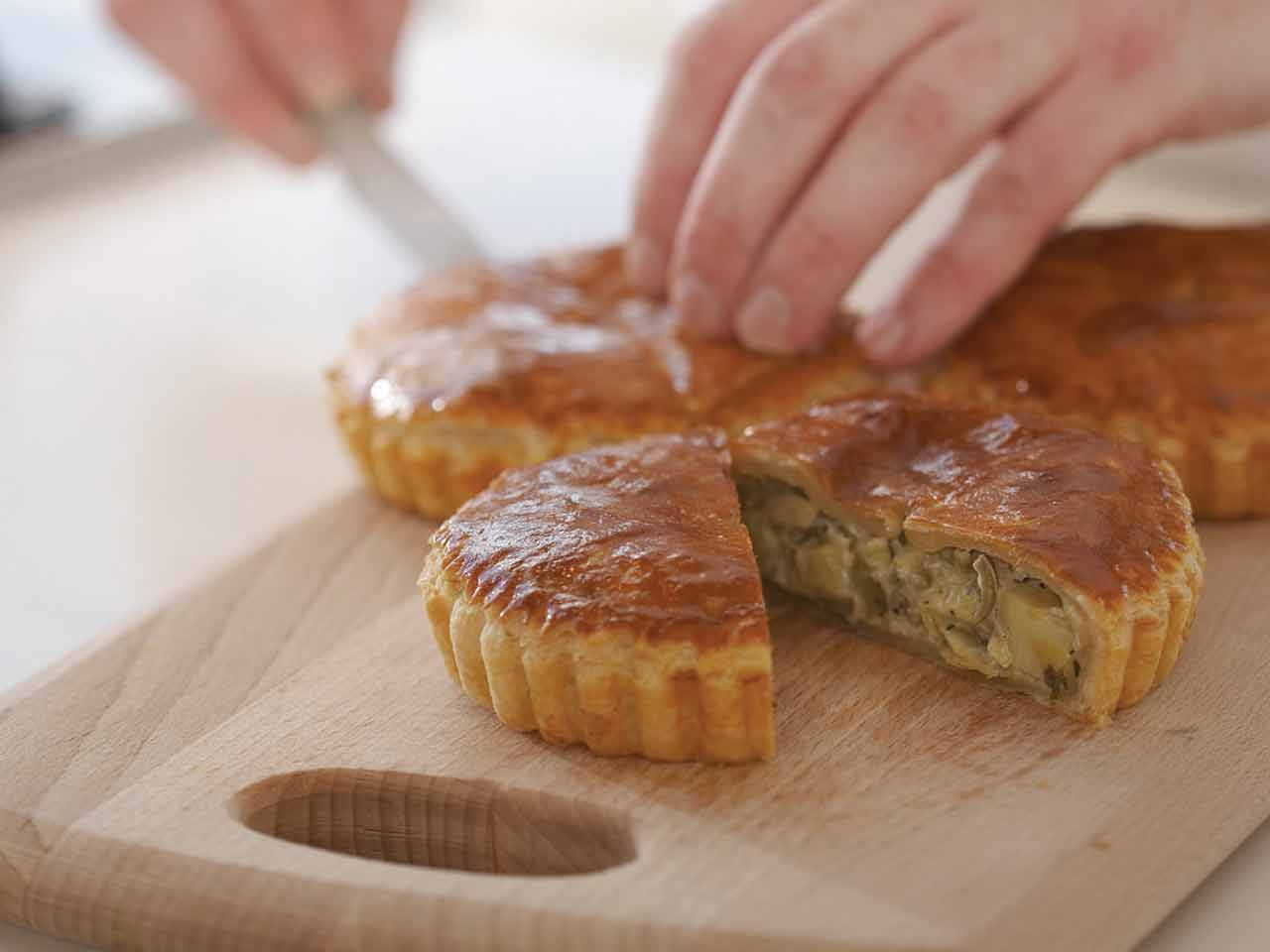 Artichoke and olive puff pastry pies