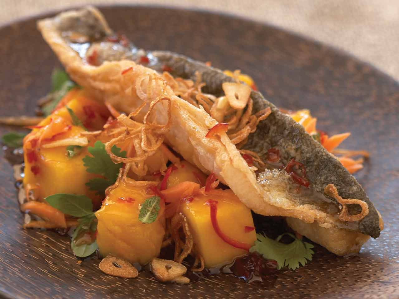Crisp-fried sea bass in sweet chilli sauce, with mango and mint salad