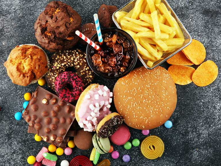 Processed foods include crisps, sweets and soft drinks.