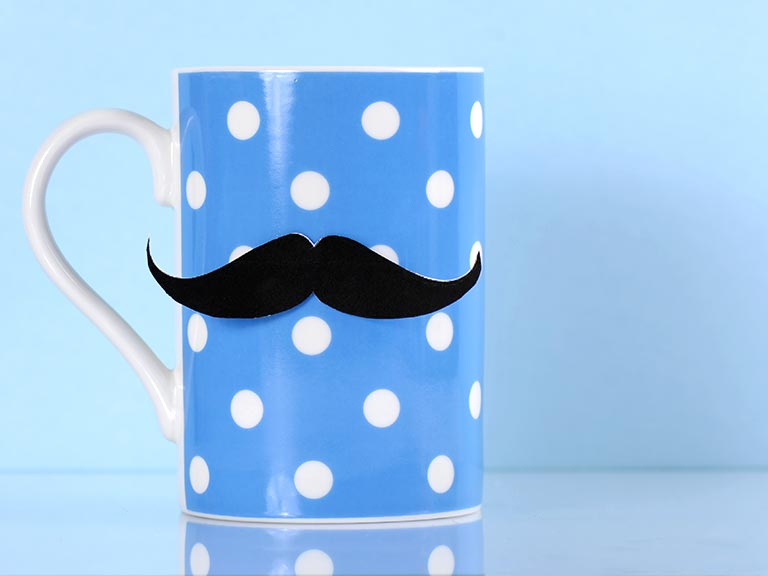 Blue and white spotty mug sporting moustache for men's health awareness