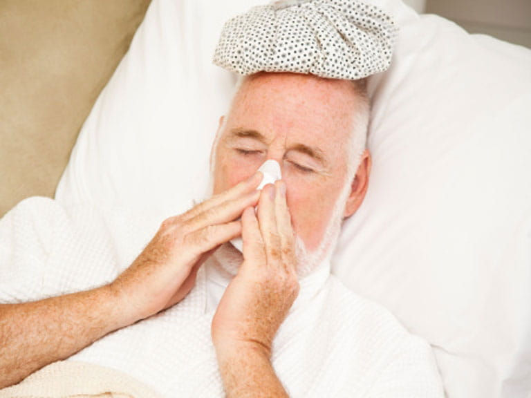 Man in bed with a bad cold
