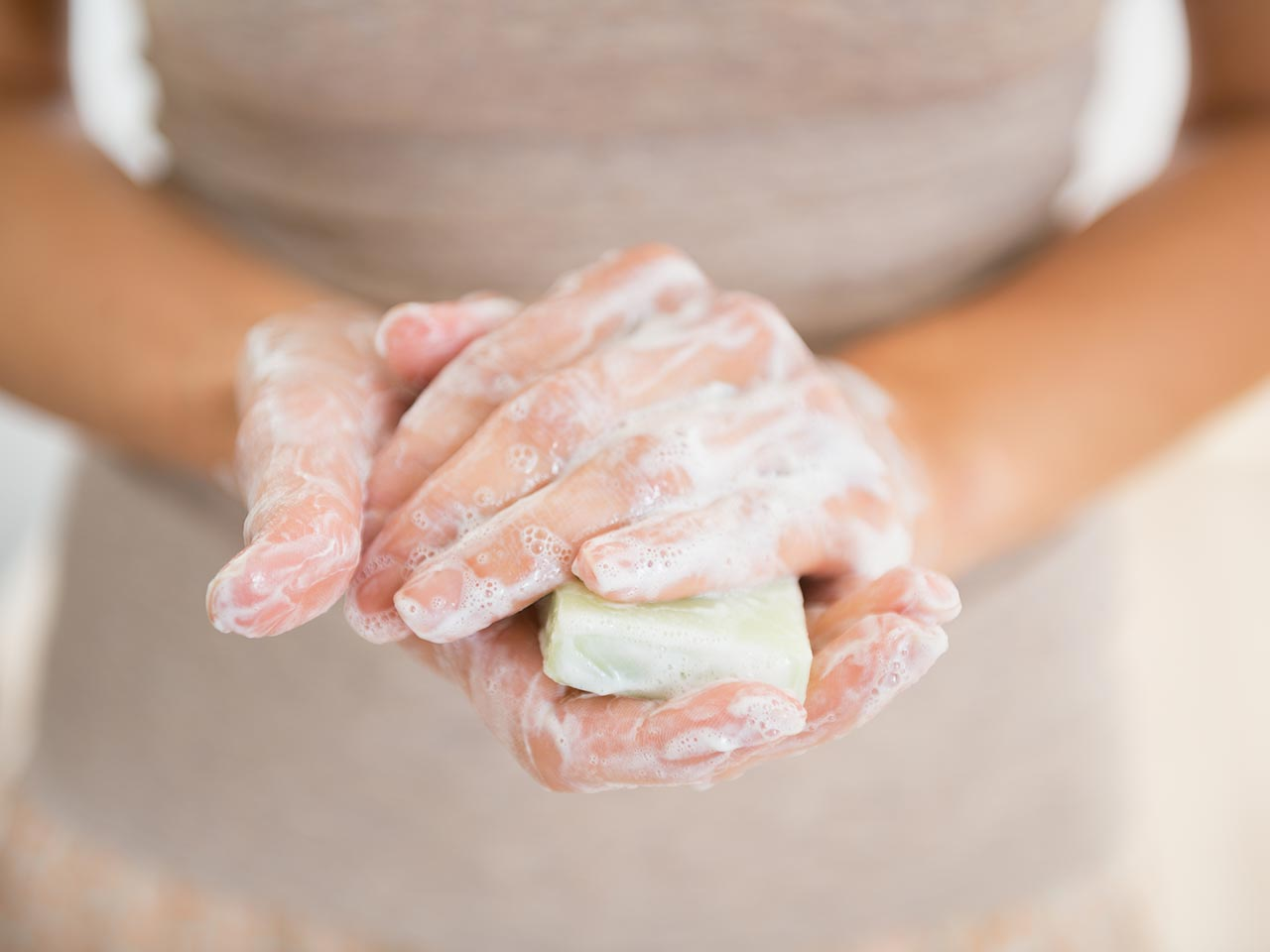 Lady washing hands with soap