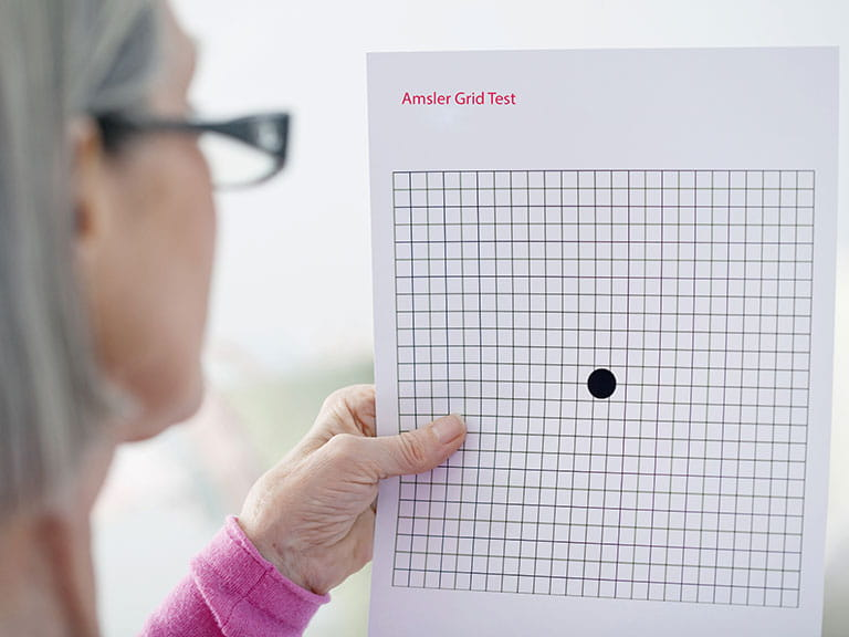 Senior woman taking AMD sight test