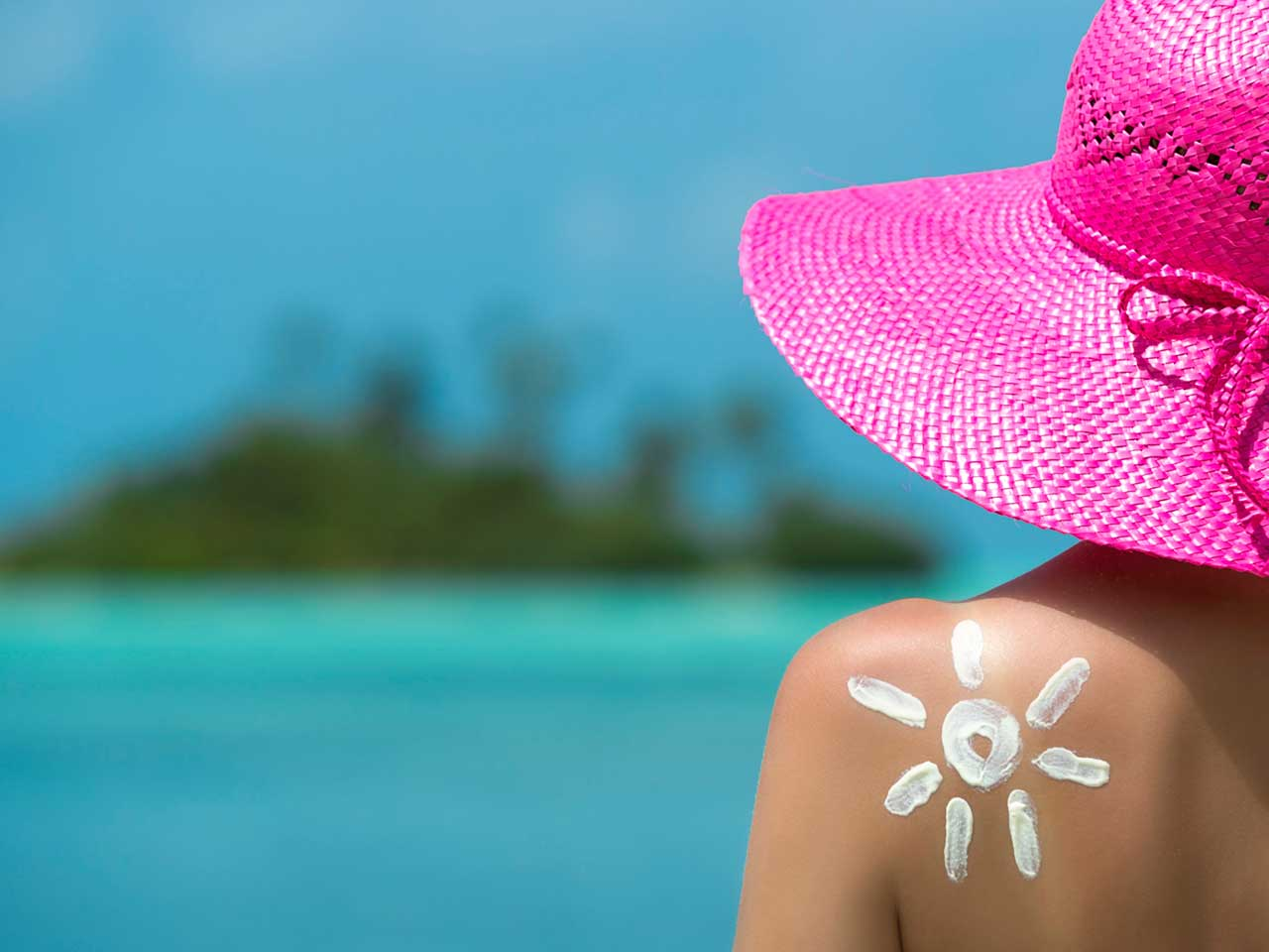 Woman in sunhat on holiday