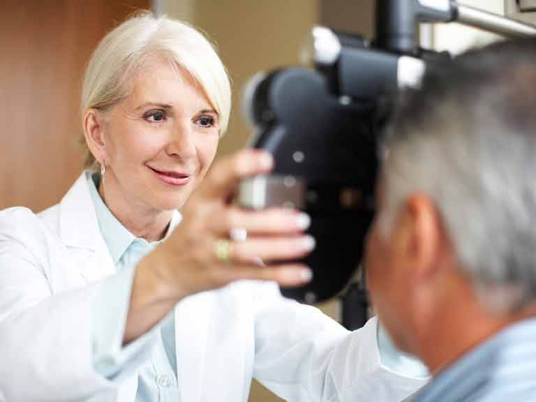 Optometrist or optician conducting an eye test