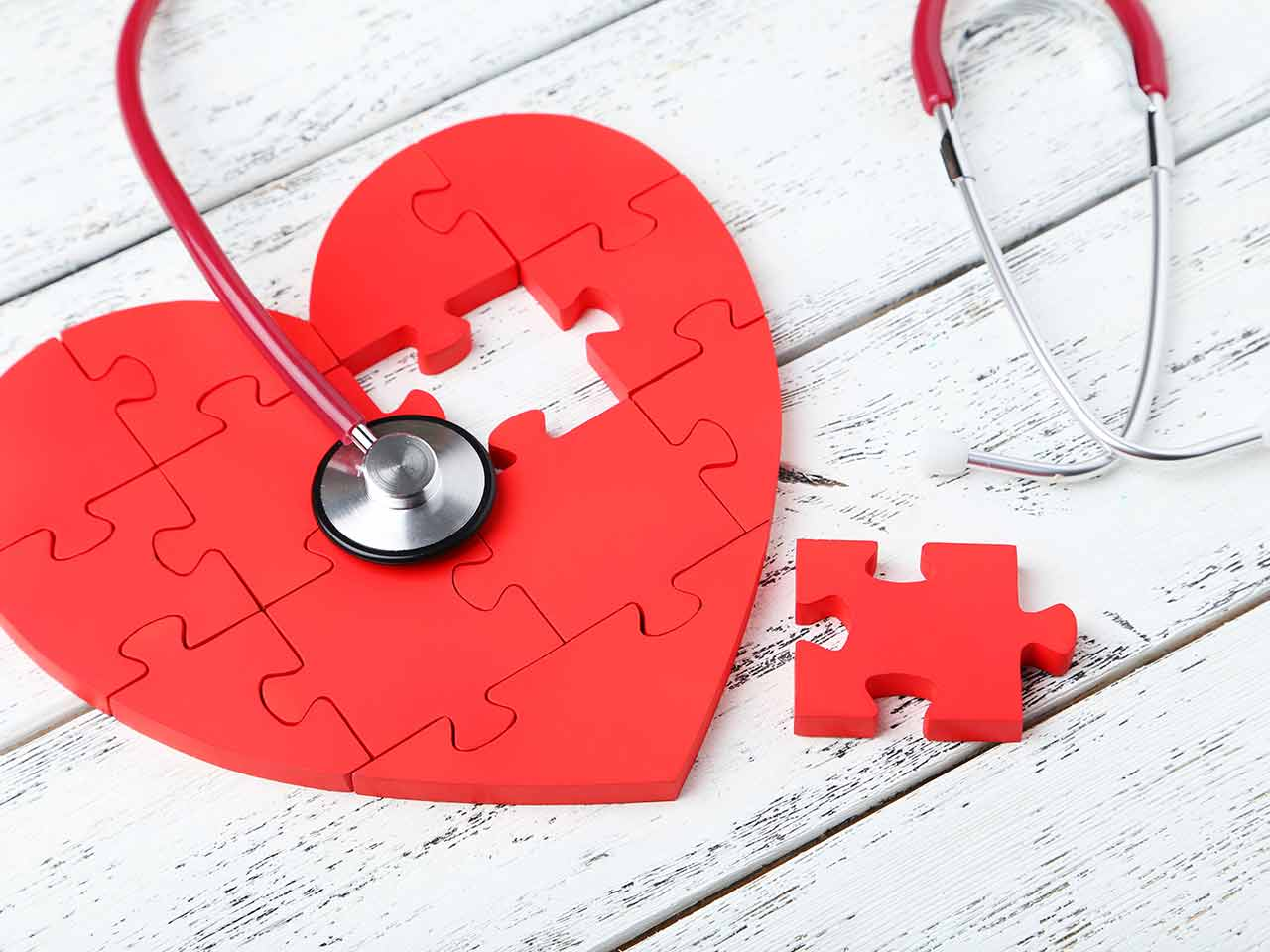 Heart puzzle with piece missing and stethoscope