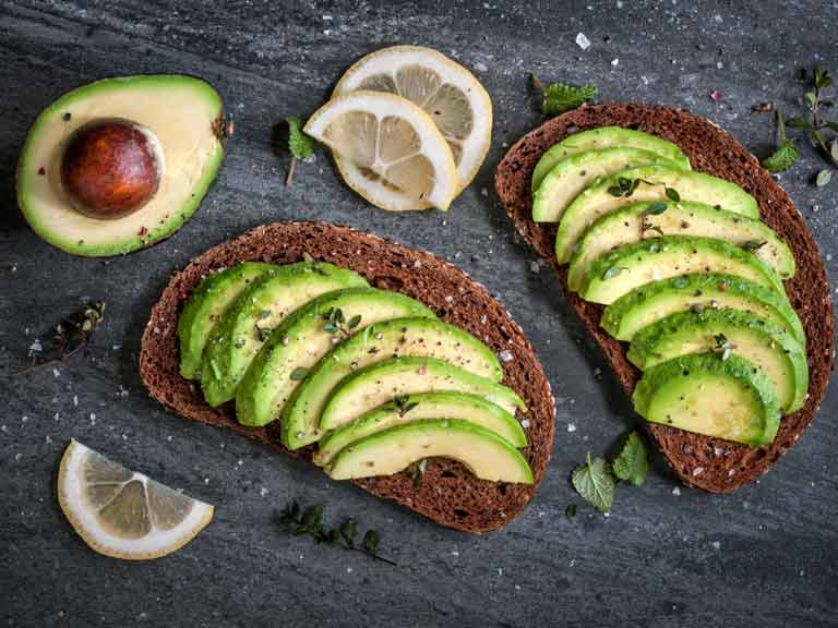 Foods like avocado are chock-full of healthy fats, but don't over-do it if you want to stay slim