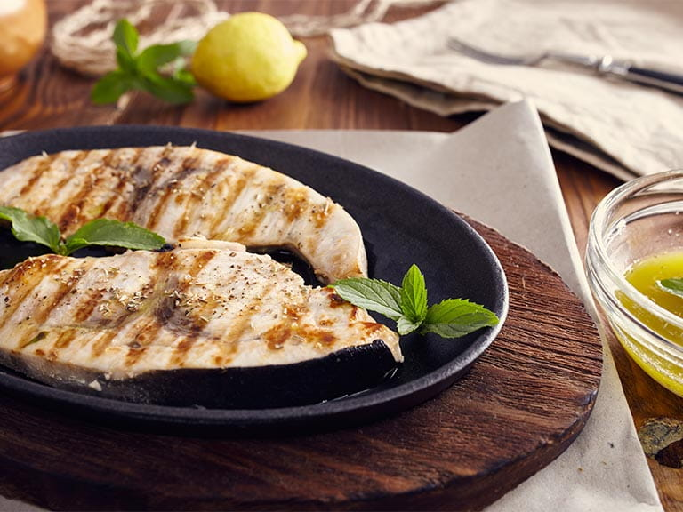 Swordfish steaks in a pan