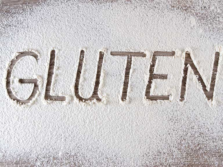 Word gluten written in flour