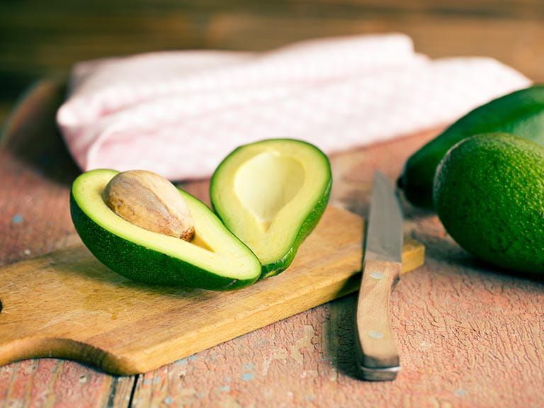 Avocados on a chopping board