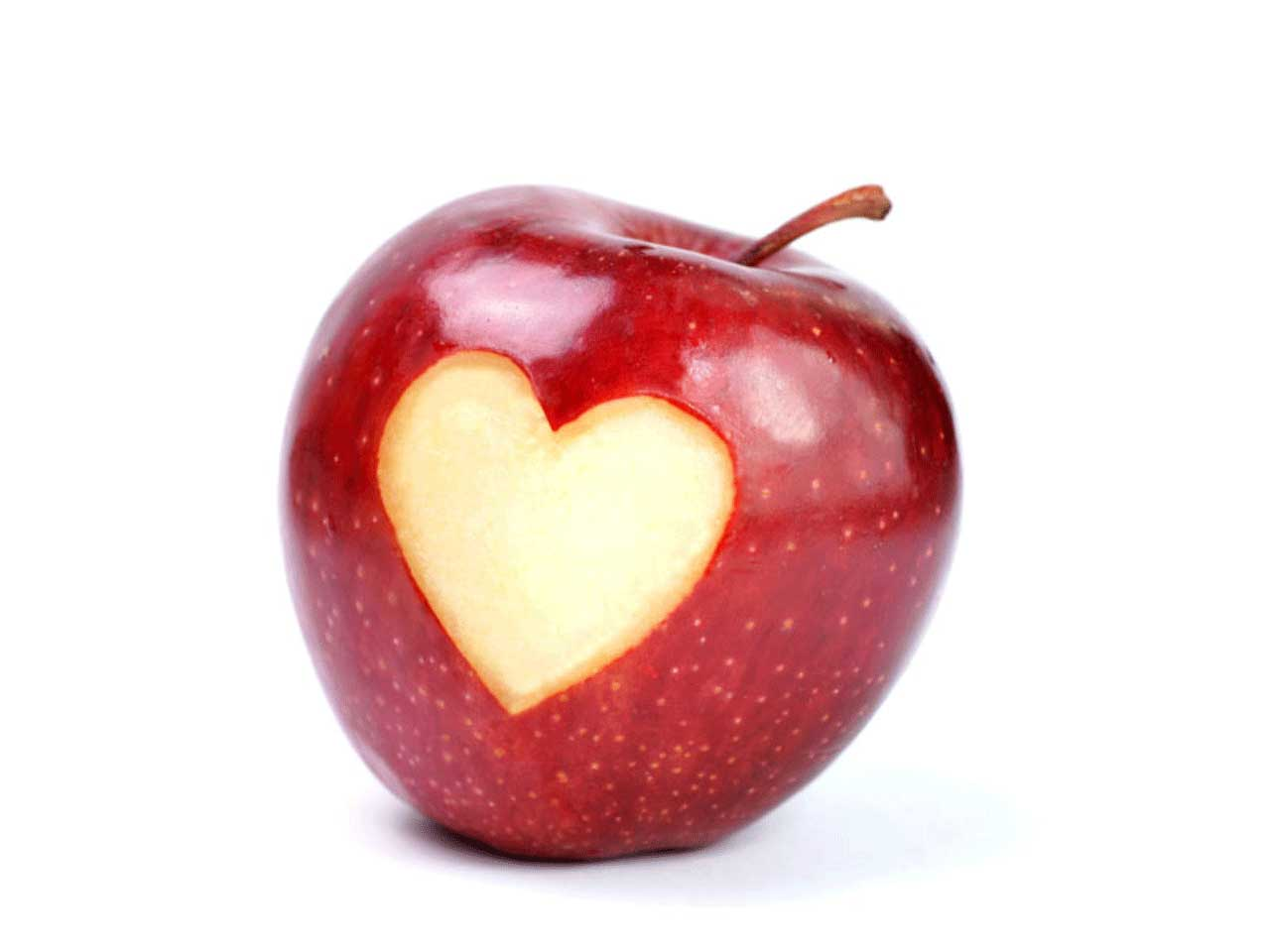 Apple with a heart cut out of it